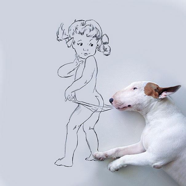 bull terrier con niña jugando